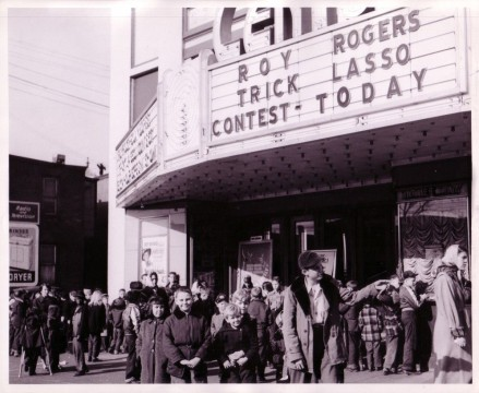 Kids wait outside a theater holding a Roy Rogers Trick Lasso Contest, Roy Rogers and Dale Evans Archives, Library and Archives, Autry Museum; T2010-28.